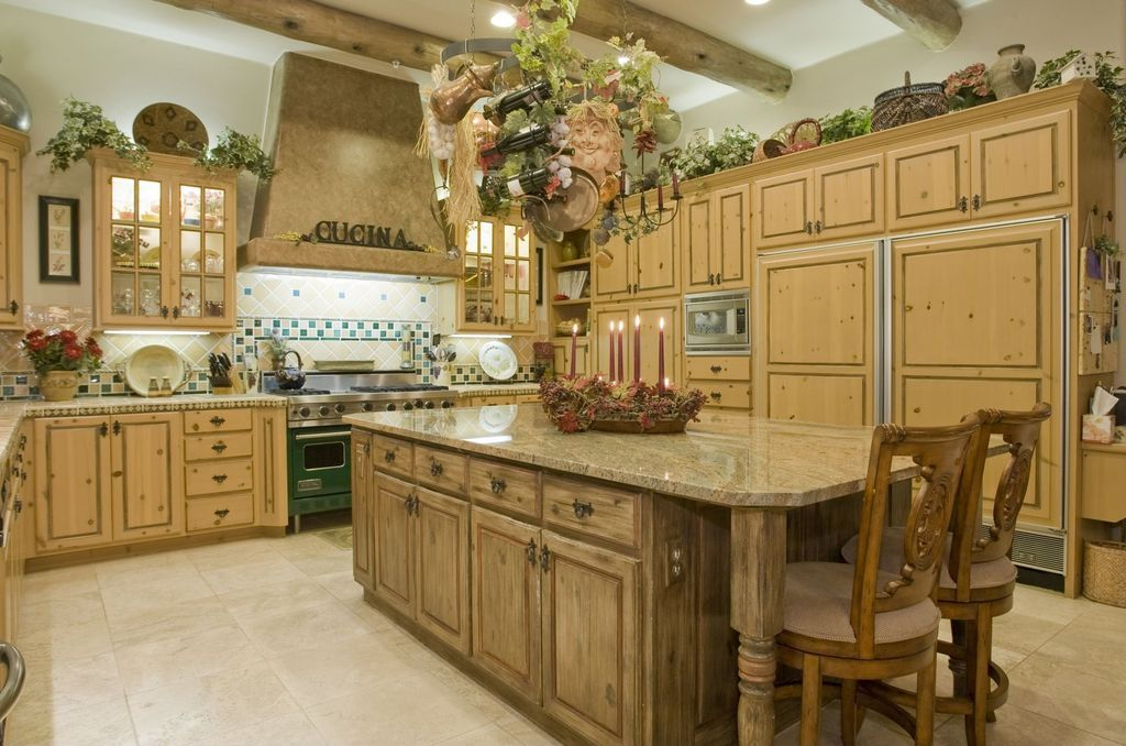 Traditional kitchen with custom hood exposed beam in for Traditional european kitchen