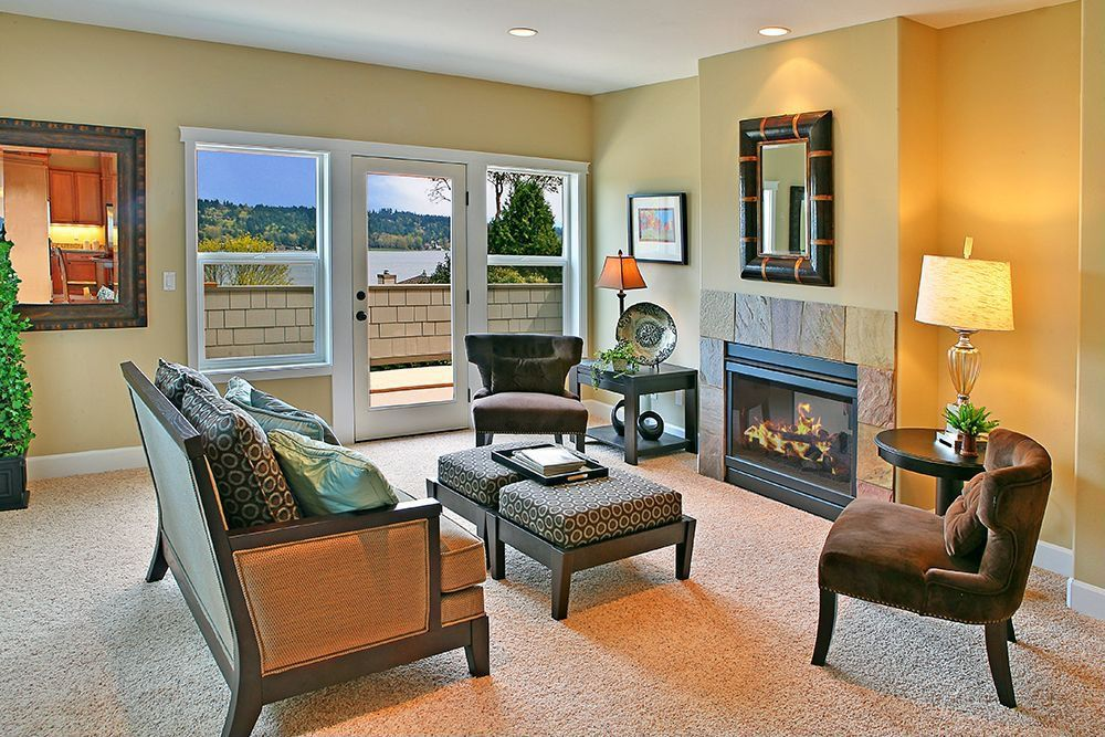 Modern Living Room with brick fireplace, Standard height, double-hung window, French doors, can lights, Fireplace, Mural