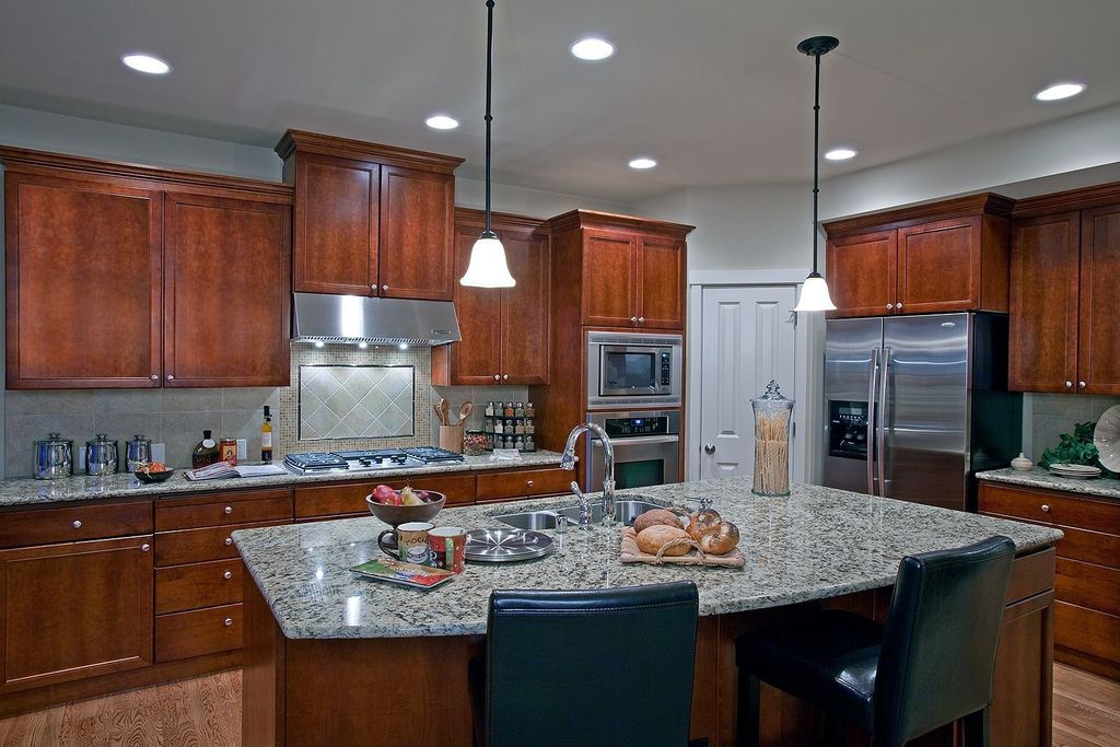 Traditional Kitchen with Kitchen island, Wall Hood, full backsplash, Simple granite counters, Flat panel cabinets, can lights