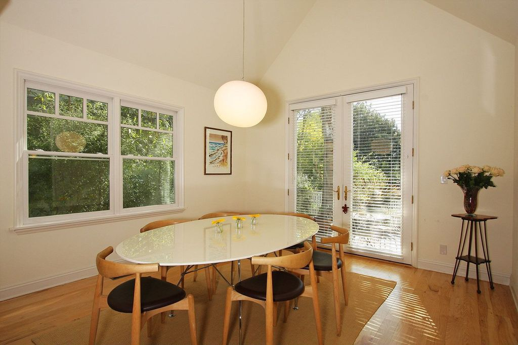 Modern Dining Room with Pendant light, Ceiling fan, Standard height, French doors, double-hung window, Laminate floors