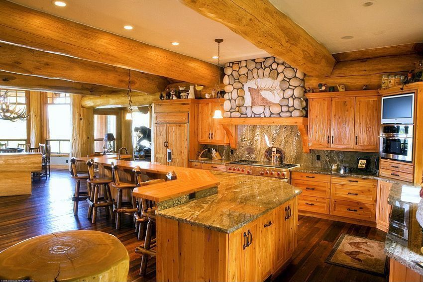 Rustic Kitchen with wall oven, Eldorado stone river rock, Complex granite counters, Kitchen island, European Cabinets, Flush