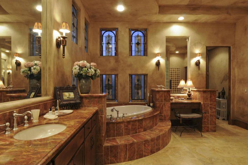 Mediterranean Master Bathroom with Venetian plaster, Kichler paramount 1 light wall sconce, Stained glass window, flush light