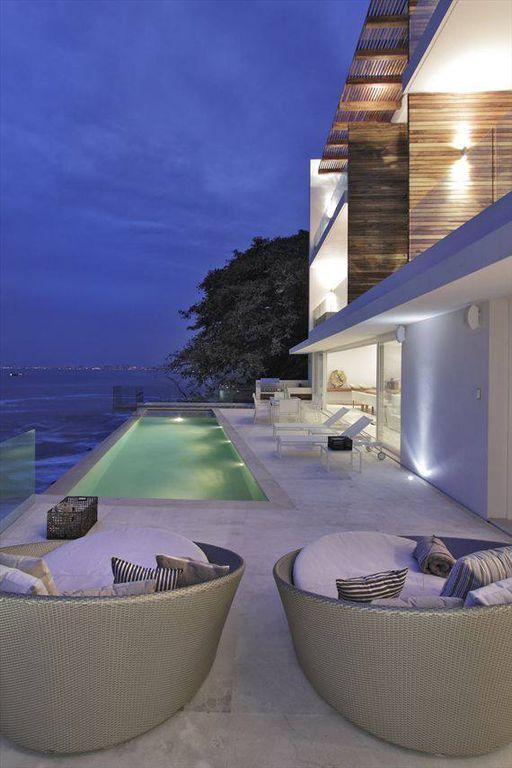 Contemporary Swimming Pool with exterior tile floors, Outdoor kitchen, Trellis, picture window, exterior concrete tile floors