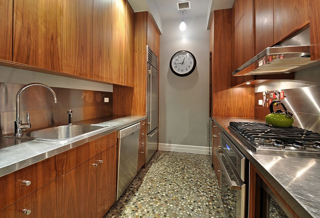 Modern Kitchen with can lights, Stainless Steel, Stainless steel counters, Wall Hood, Galley, ceramic tile floors, dishwasher