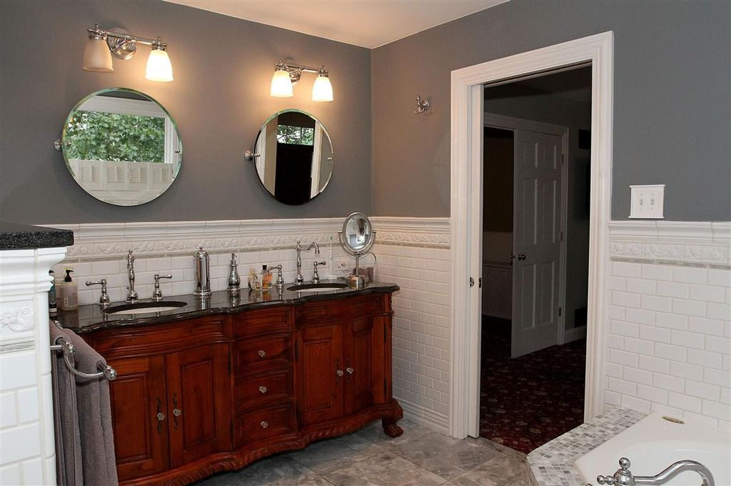 traditional master bathroom with minka lavery 2 light vanity light