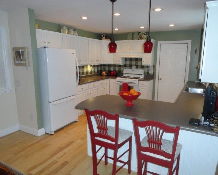 Country Kitchen with Framed Partial Panel, Custom hood, can lights, Breakfast bar, Laminate countertop, Casement, Paint 1