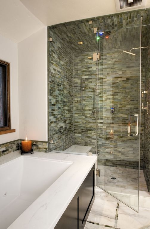 Contemporary Master Bathroom with Undermount bathtub, partial backsplash, Built in shower seat, Pental aspen honed marble