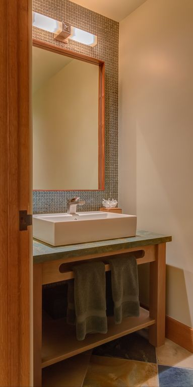 Contemporary Powder Room with stone tile floors, Vessel sink, wall-mounted above mirror bathroom light, Slate counters