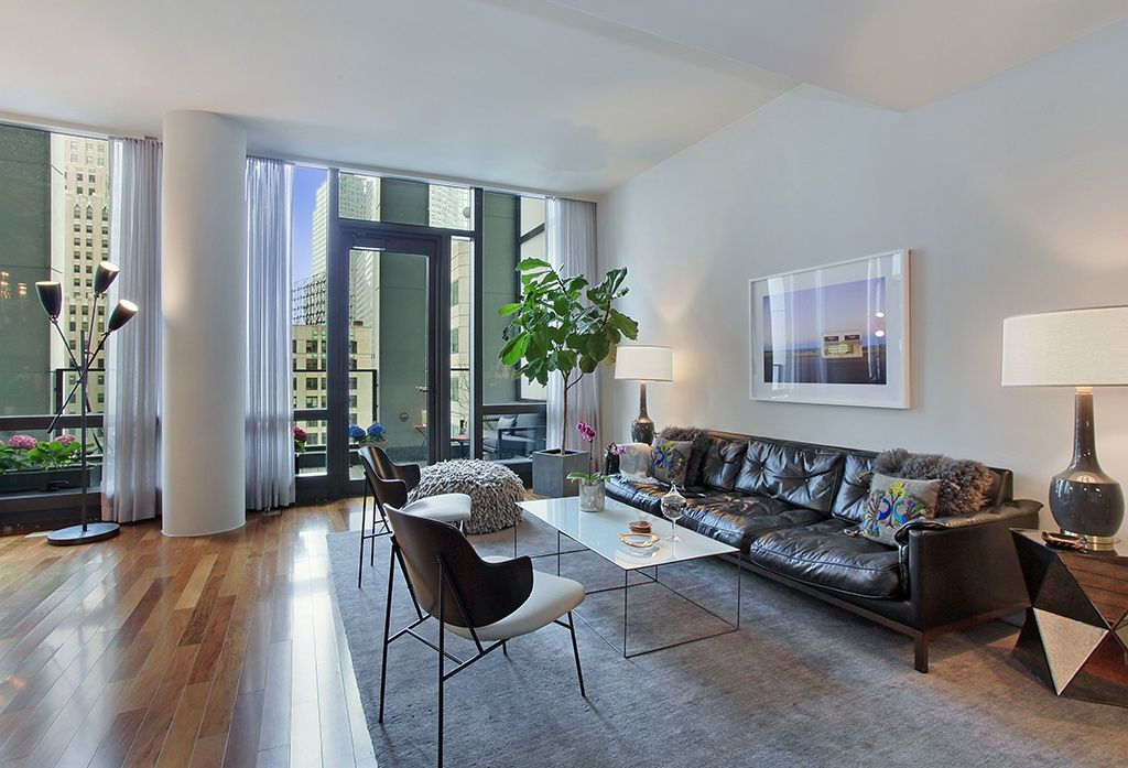 Contemporary Living Room with Hardwood floors, Glass panel door, High ceiling, Columns, can lights, Transom window