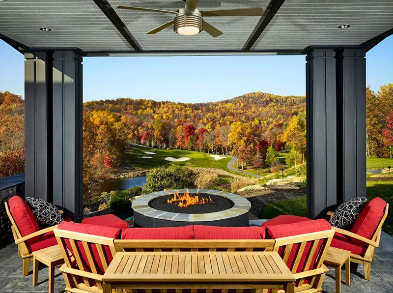 Contemporary Porch with Screened porch, exterior stone floors, Pond, Teak patio sofa set, Fire pit
