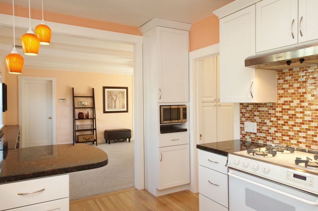 Contemporary Kitchen with L-shaped, Standard height, can lights, full backsplash, Wall Hood, European Cabinets, Paint 1