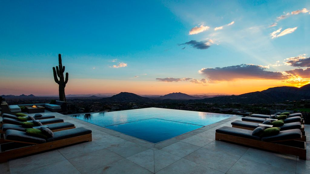 Contemporary Swimming Pool with exterior stone floors, Infinity pool, Pathway, Fire pit