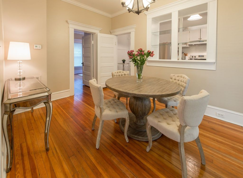 Contemporary Dining Room with Standard height, Crown molding, Hardwood floors, Chandelier, specialty door