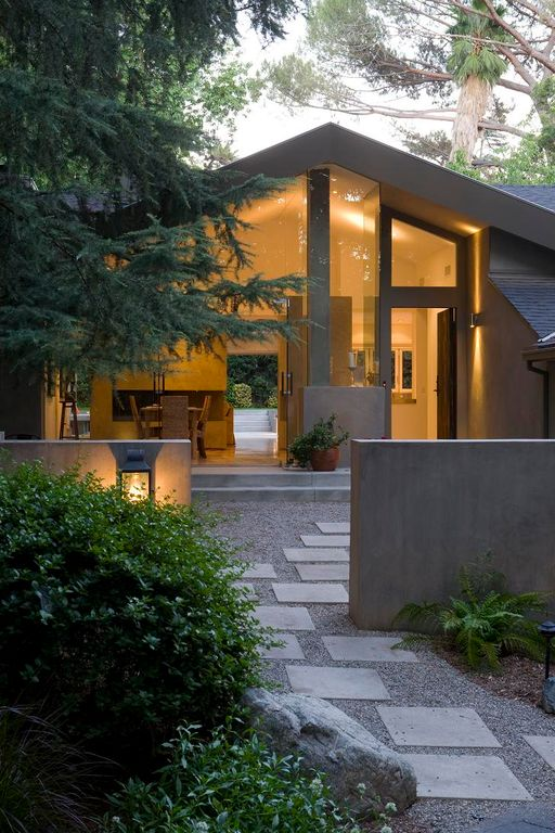 Contemporary Landscape/Yard with Fence, exterior tile floors, sliding glass door, exterior concrete tile floors, Raised beds