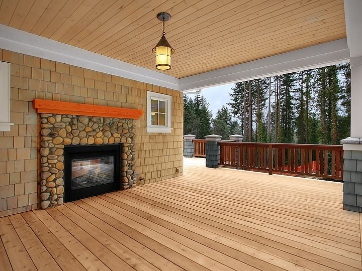 Traditional Deck with Pathway, Outdoor fireplace, Wood paneled ceiling