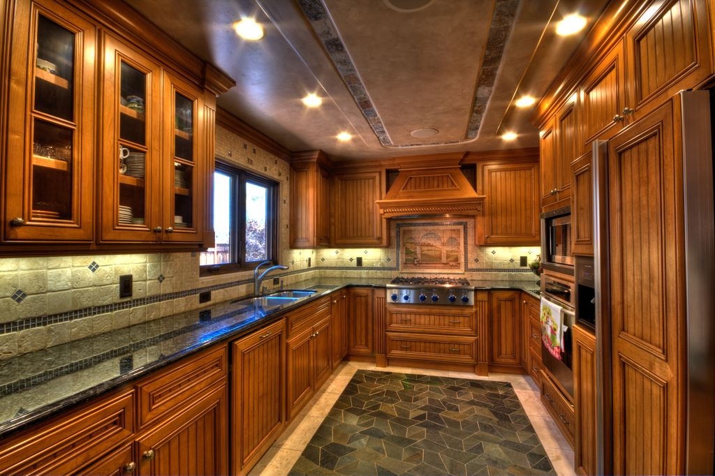 Craftsman Kitchen with double wall oven, limestone tile floors, U-shaped, Complex granite counters, electric cooktop