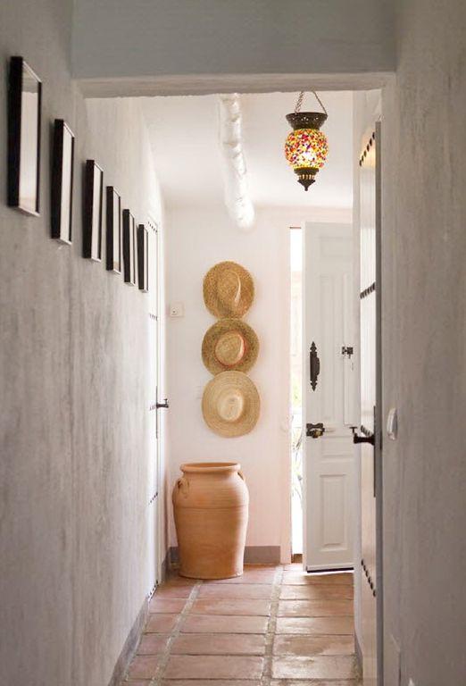 Eclectic Entryway with Exposed beam, terracotta tile floors, six panel door, Chandelier, flat door, High ceiling