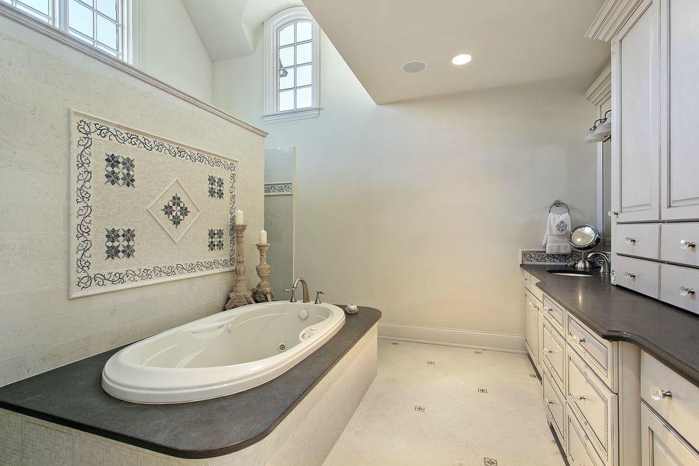 Traditional Master Bathroom with Shower, drop in bathtub, Ceramic Tile, Raised panel, Bathtub, full backsplash, Flush