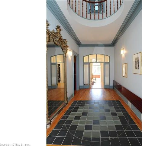 Traditional Entryway with Standard height, Hardwood floors, Crown molding, Transom window, French doors