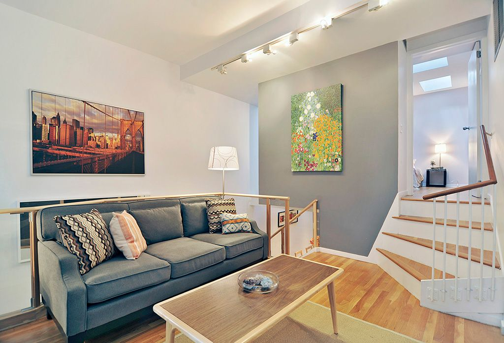 Contemporary Living Room with Hardwood floors, Poundex blue grey blended linen sofa, Brooklyn bridge at sunset