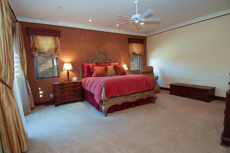 Eclectic Guest Bedroom with Ceiling fan, specialty window, Carpet, Standard height, can lights