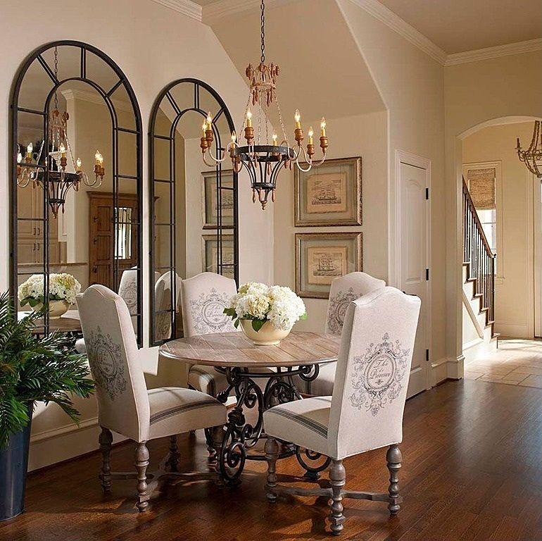 Traditional Dining Room with High ceiling, Hardwood floors, six panel door, Paint, Chandelier, Crown molding