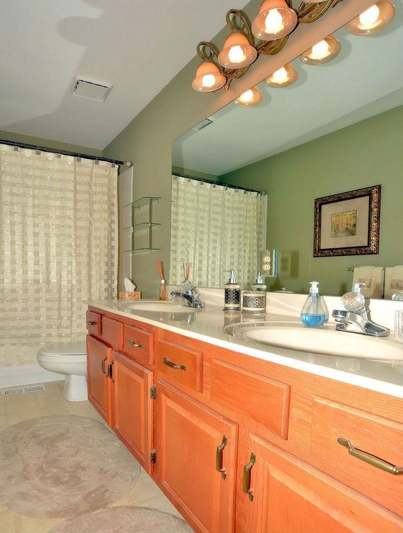 Traditional Master Bathroom with Raised panel, Corian counters, Framed Partial Panel, Shower, tiled wall showerbath, Bathtub