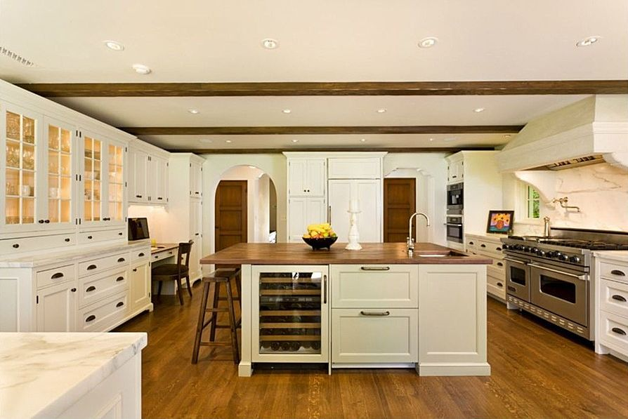 Traditional Kitchen with Complex marble counters, Wine refrigerator, Panel ready under counter wine refrigerator, Glass panel
