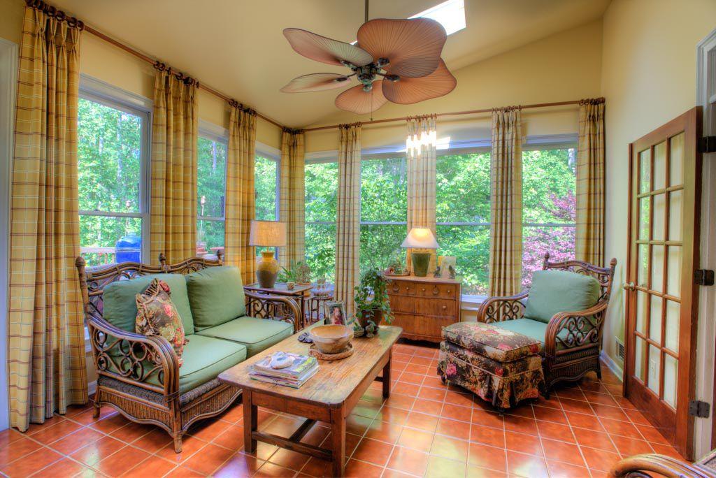 Tropical Living Room With Flush Light Terracotta Tile Floors In Norcros