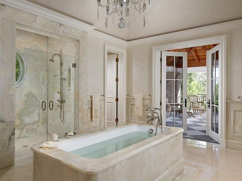 Traditional Master Bathroom with Bathtub, Louvered door, Shower, Complex marble counters, Chandelier, French doors