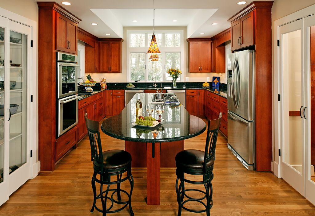 Traditional Kitchen with Kitchen island, Quartz counters, Flat panel cabinets, Undermount sink, High ceiling, Breakfast bar