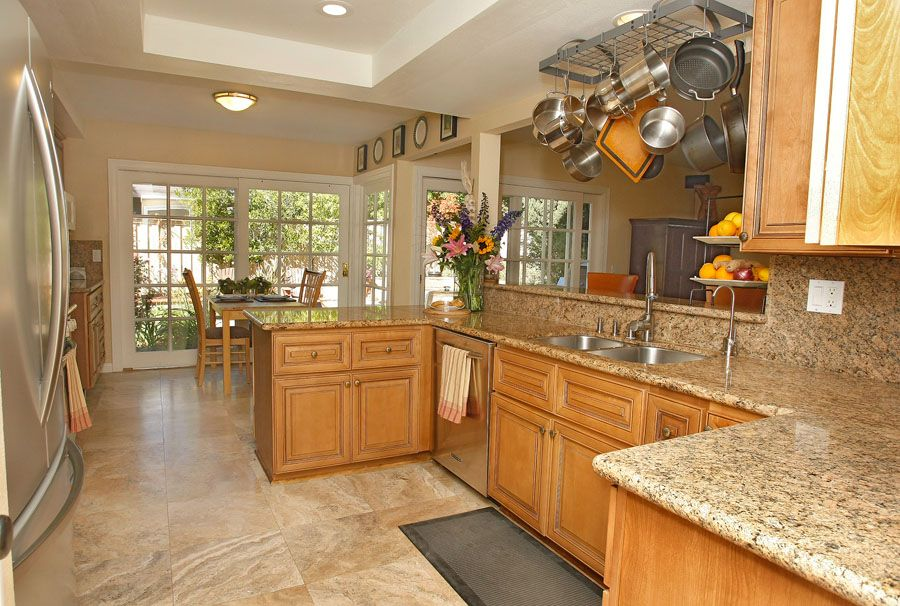 Traditional Kitchen with full backsplash, Simple Granite, French doors, flush light, Galley, Multiple Sinks, Raised panel