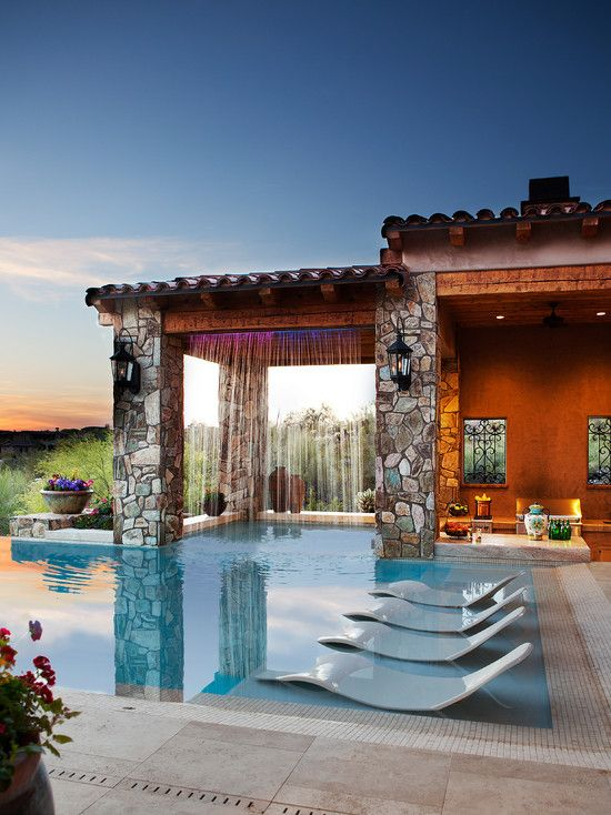 Contemporary Swimming Pool with exterior stone floors, Paint, Stacked stone column, Waterfall, Custom pool waterfall
