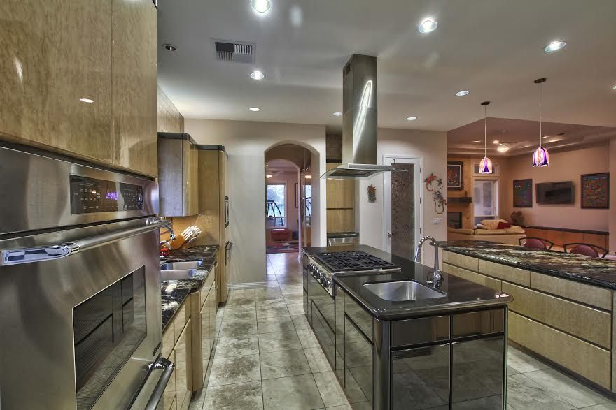 Contemporary Kitchen with L-shaped, Soapstone counters, Breakfast bar, electric cooktop, flush light, built-in microwave