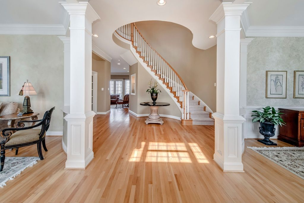 Traditional Entryway with Columns, can lights, Crown molding, Standard height, Hardwood floors