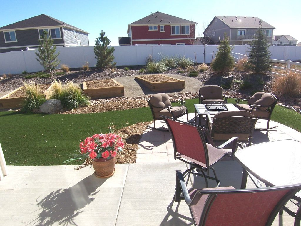 Traditional Landscape/Yard with exterior tile floors, Raised beds, Fence, picture window, exterior concrete tile floors