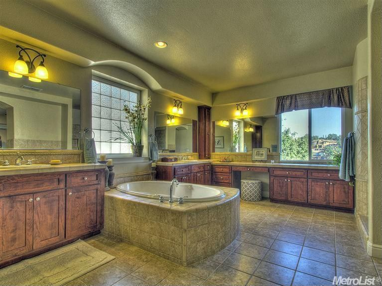 Country Master Bathroom with Casement, Wall Tiles, stone tile counters, Stone Tile, Limestone Tile, Standard height, Bathtub