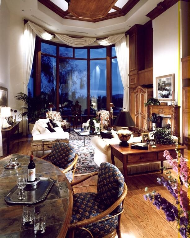 Traditional Great Room with picture window, Fireplace, Built-in bookshelf, can lights, brick fireplace, Laminate floors