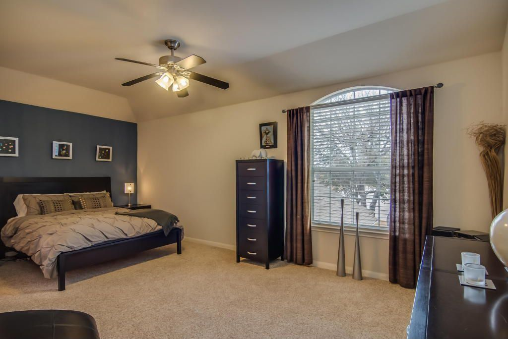 Contemporary Master Bedroom with Standard height, Ceiling fan, Carpet, Arched window