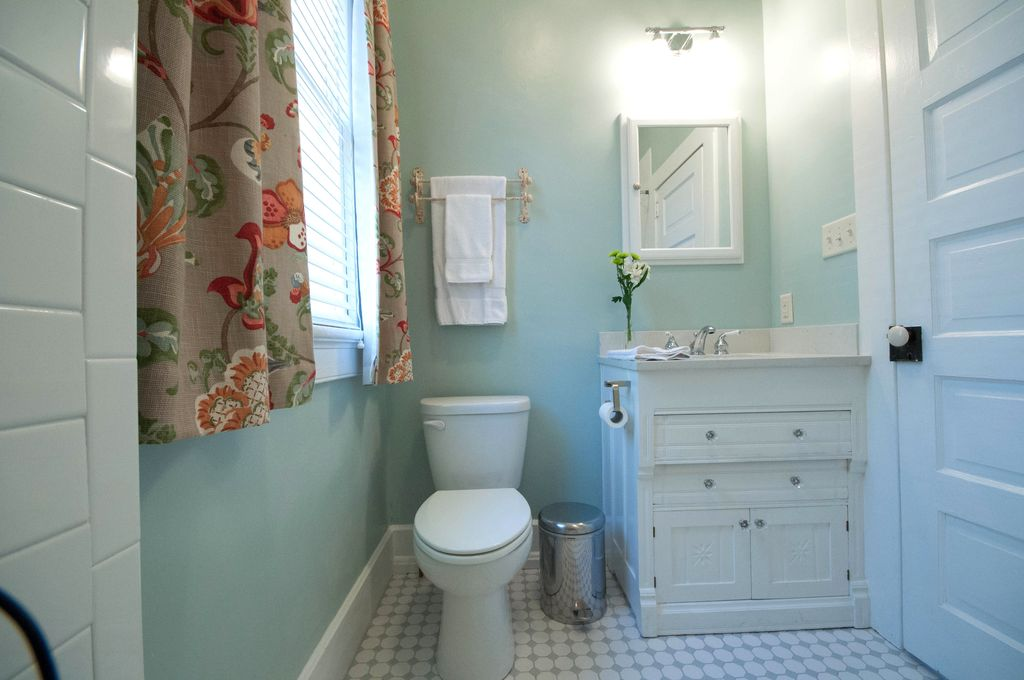 Traditional Powder Room with partial backsplash, Powder room, Paint 1, specialty door, Undermount sink, Casement, Wall Tiles