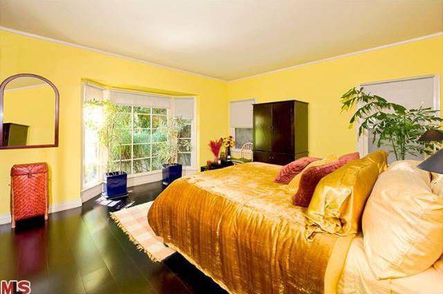 Eclectic Guest Bedroom with Casement, Standard height, Concrete floors