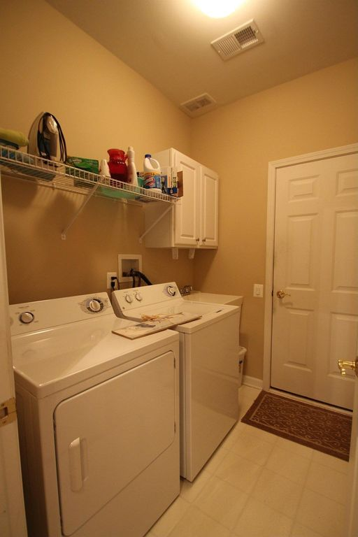 Traditional Laundry Room with Undermount sink, Standard height, Drying Rack, laundry sink, six panel door, Built-in bookshelf