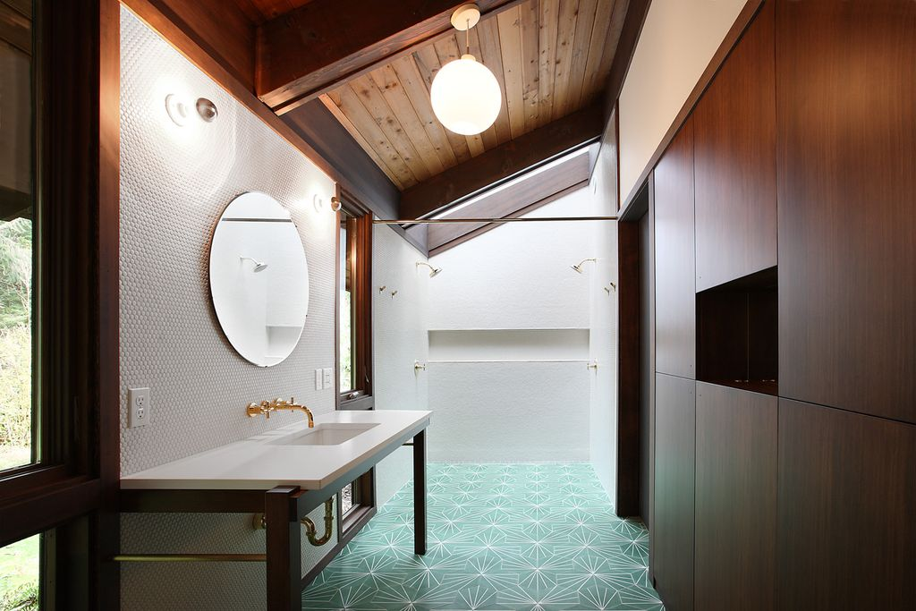 Modern Master Bathroom with European Cabinets, Flush, Skylight, Undermount sink, Corian counters, Exposed beam, Wall sconce