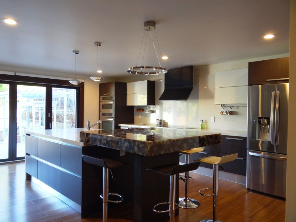 Traditional Kitchen with Complex granite counters, double wall oven, European Cabinets, Multiple Refrigerators, Paint 1