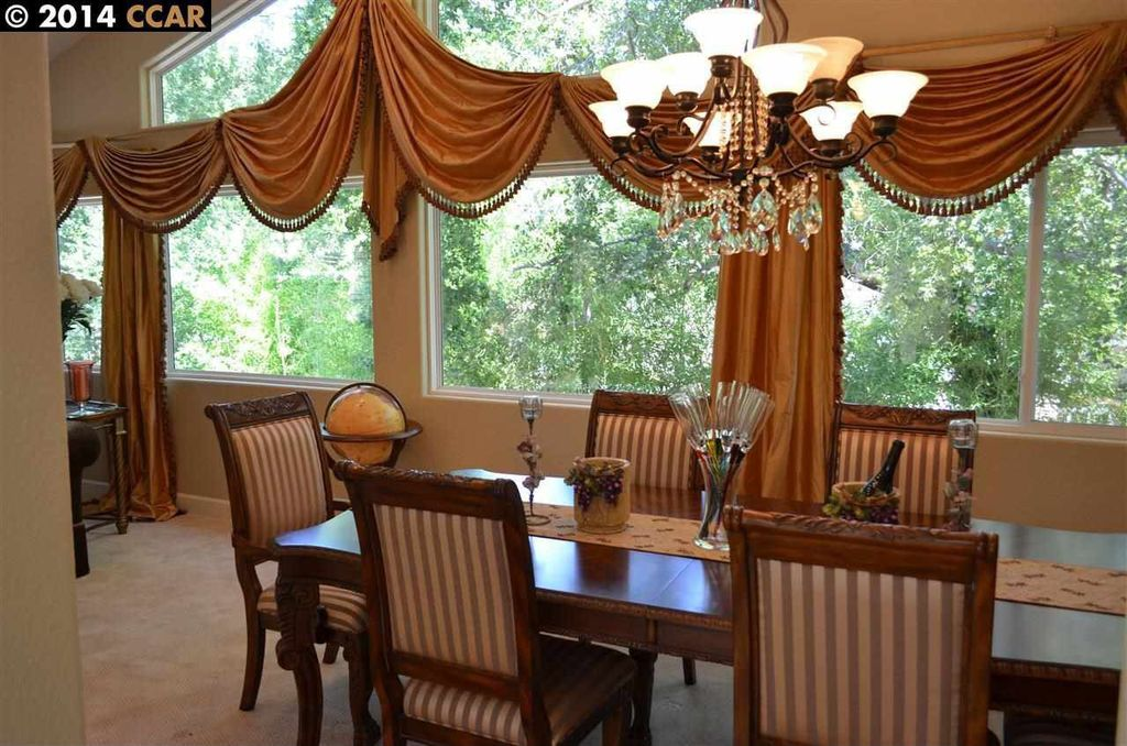 Traditional Dining Room with High ceiling, Chandelier, Carpet