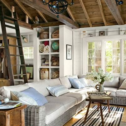 Contemporary Living Room with Exposed beam, Dash and albert weather-resistant area rug, Pine flooring, Casement, High ceiling