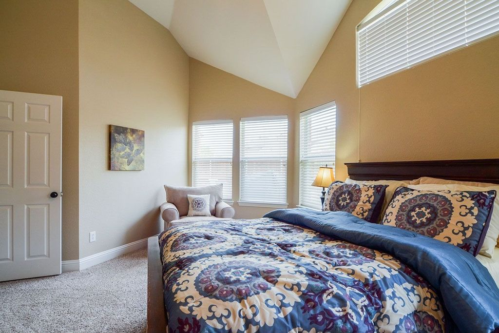 Traditional Guest Bedroom with High ceiling, picture window, double-hung window, Carpet, six panel door
