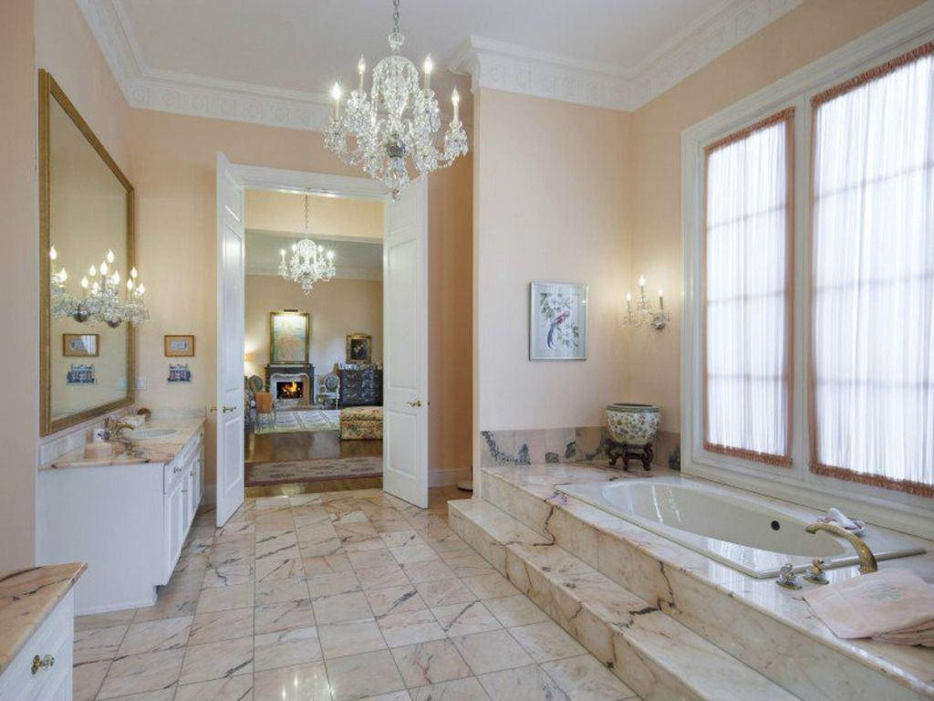 Traditional Master Bathroom with Master bathroom, stone tile floors, picture window, Standard height, Crown molding, Flush