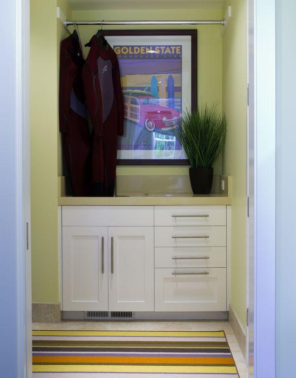Modern Closet with Standard height, simple granite tile floors, stone tile floors
