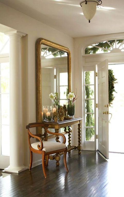 Traditional Entryway with Engineered hardwood flooring, Standard height, six panel door, flush light, Hardwood floors